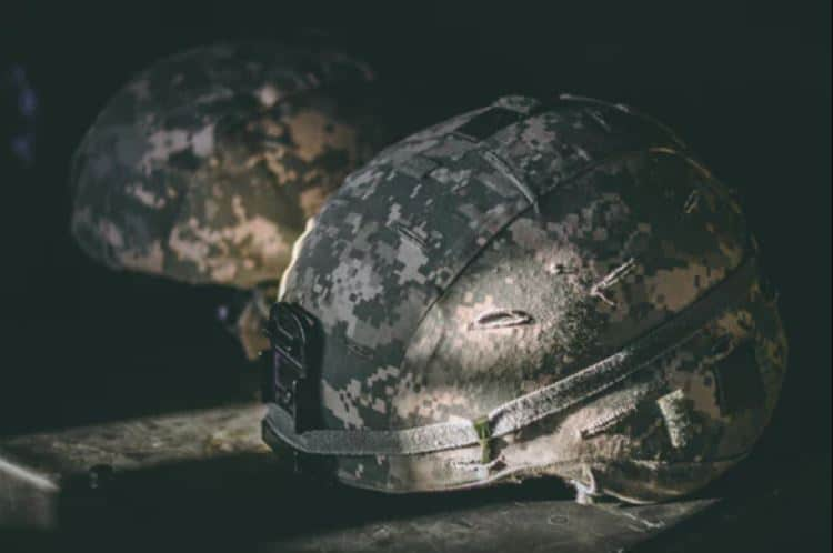 Army helmets on the ground.